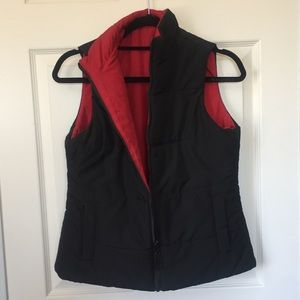 Black and red reversible vest.
